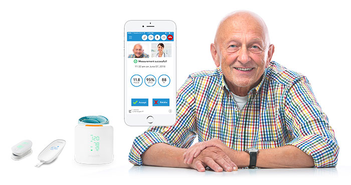 Elderly Man with Live Expert Mobility Home Healthcare App on iPhone Synced with Blood Pressure Cuff